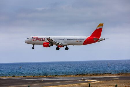 jetblue: ARECIFE, SPAIN - APRIL, 15 2017: AirBus A321 of IBERIA with the registration EC-JOM landing at Lanzarote Airport