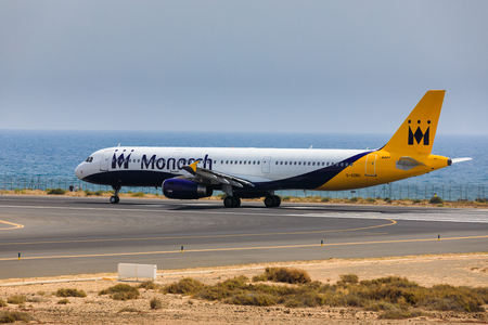 aerodynamic: ARECIFE, SPAIN - APRIL, 16 2017: AirBus A321 of Monarch Airlines with the registration G-OZBU ready to take off at Lanzarote Airport
