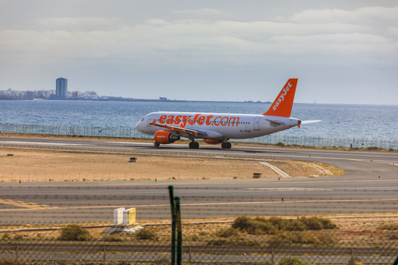april 15: ARECIFE, SPAIN - APRIL, 15 2017: AirBus A320 of easyjet.com ready to take off at Lanzarote Airport Editorial