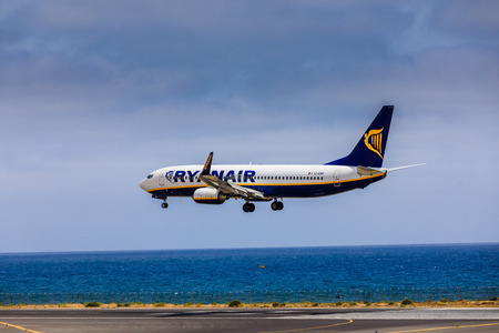 april 15: ARECIFE, SPAIN - APRIL, 15 2017: Boeing 737-800 of RYANAIR with the registration EI-ENP landing at Lanzarote Airport Editorial