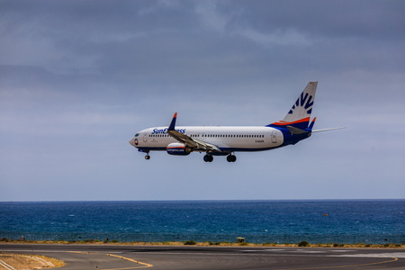 ARECIFE, SPAIN - APRIL, 15 2017: Boeing 737 - 800 of SunExpress with the registration D-ASXR landing at Lanzarote Airport Editorial