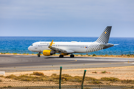 april 15: ARECIFE, SPAIN - APRIL, 15 2017: AirBus A320 of vueling.com with the registration EC-LYP ready to take off at Lanzarote Airport
