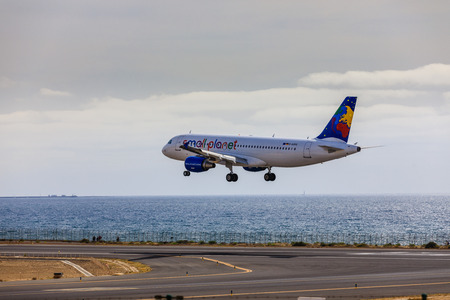 april 15: ARECIFE, SPAIN - APRIL, 15 2017: AirBus A320 of small planet with the registration D-ASPG landing at Lanzarote Airport Editorial