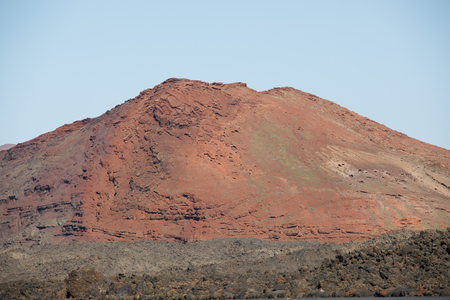 Volcanic, but green landscape on Lanzarote. 版權商用圖片