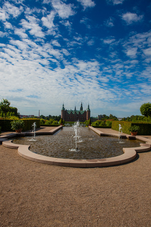 A fountain in the beautiful parkland around the great castle Frederiksborg Castle in Denmark Editorial