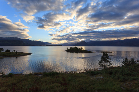hardanger: A beautiful and magical evening somewhere along the Hardangerfjord in Norway. Stock Photo