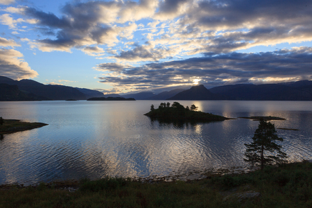 A beautiful and magical evening somewhere along the Hardangerfjord in Norway. Stock Photo