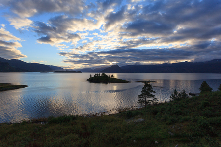 A beautiful and magical evening somewhere along the Hardangerfjord in Norway. Standard-Bild