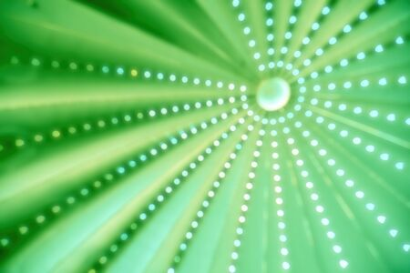 Bright aperture circles against a green background