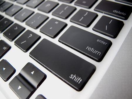 enter key: Black Enter Key on Silver Keyboard
