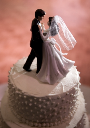 Figures of Bride and Groom dancing on a Wedding Cake