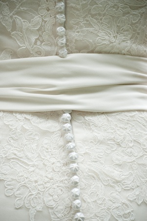 Closeup of the back of a wedding gown