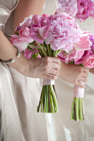 Wedding Bouquets in the Hands of Bridesmaids photo