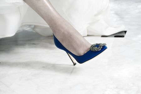 Blue Shoe on the Foot of a Bride photo