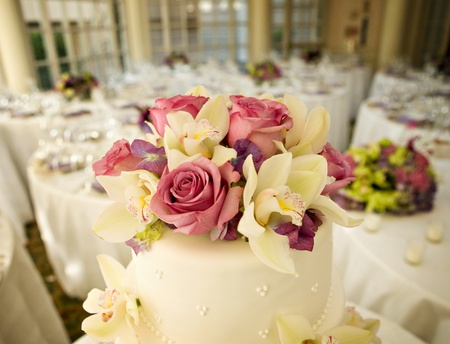 Wedding Cake with Roses and Tropical Flowers photo