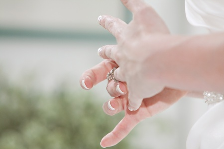 Young Woman tries on her wedding ring