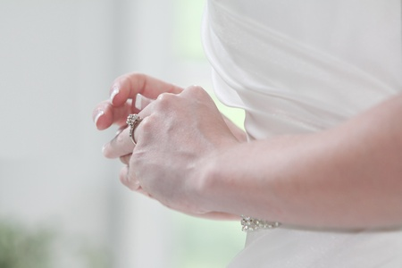 tries: Young Woman tries on her wedding ring