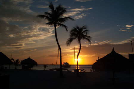 noord: The sun is setting across the ocean waters of Palm Beach in the town of Noord.