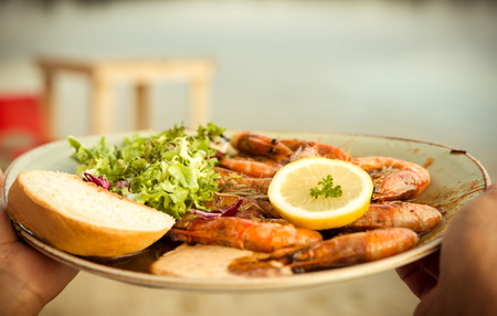 gambas: Plate of freshly grilled Gambas with salad, lemon, and bread