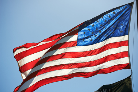spangled: Illuminated Star Spangled Banner on Blue Sky