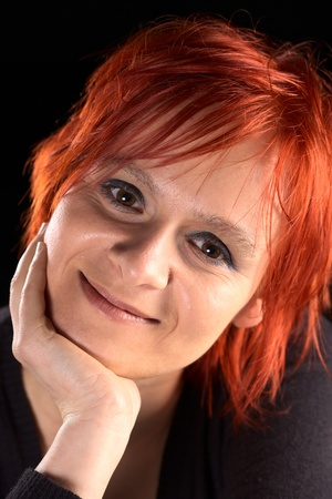 Smiling young Caucasian woman with short red hair (Selective Focus, Focus on the eyes) photo