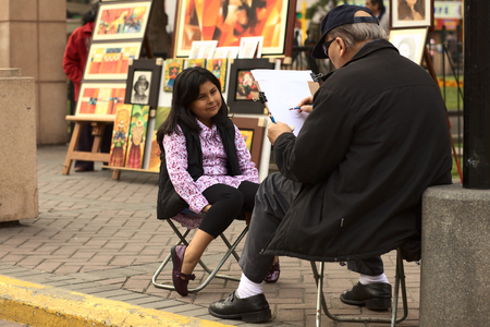 LIMA, PERU - SEPTEMBER 25, 2011: Unidentified street artist drawing a picture of an unidentified young Peruvian girl on September 25, 2011 in the district of Miraflores in Lima, Peru  Editorial