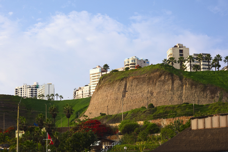 LIMA, PERU - APRIL 2, 2012: View onto the cliff line, the Parque del Amor (Park of Love) and the Malecon Cisneros from below, the Circuito de Playas on April 2, 2012 in Miraflores, Lima, Peru