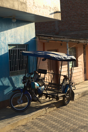 mototaxi: MANCORA, PERU - AUGUST 17, 2013: Mototaxi parking on sidewalk on August 17, 2013 in Mancora, Peru. Mototaxis (locally called Tuktuk) are a common means of transport in this small Northern Peruvian town.
