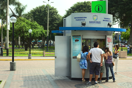miraflores district: LIMA, PERU - FEBRUARY 11, 2012  Unidentified people at the tourist information at the Kennedy Park in the district of Miraflores on February 11, 2012 in Lima, Peru  Miraflores is the most touristy district of Lima, which has the most infrastructure for to