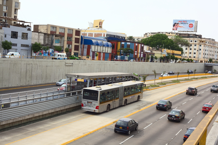 miraflores: LIMA, PERU - FEBRUARY 13, 2012  Metropolitano bus stopping at Ricardo Palma Avenue in Miraflores on February 13, 2012 in Lima, Peru  The Metropolitano is a Bus rapid transit system operating since 2010 in Lima running from North to South  Editorial