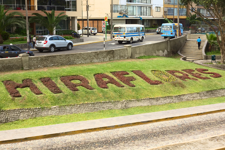 miraflores district: LIMA, PERU - MARCH 24, 2012  The name of the district of Miraflores written with plants along the roadside of Malecon 28 de Julio on March 24, 2012 in Miraflores, Lima, Peru  Miraflores is a modern and well-kept district of Lima