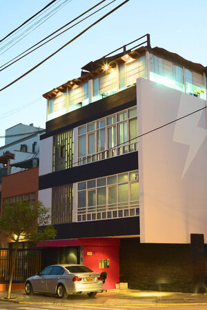 miraflores: LIMA, PERU - MARCH 29, 2012  Modern building in the evening in a street in Miraflores on March 29, 2012 in Lima, Peru  Miraflores is one of the most modern districts of Lima    Editorial