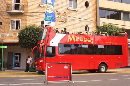 miraflores: LIMA, PERU - APRIL 1, 2012  Unidentified people on Mirabus sightseeing bus in front of the restaurant Rustica on Av  Diagonal in Miraflores on April 1, 2012 in Lima, Peru  Miraflores is the tourist district of Lima, with a lot of infrastructure for touris