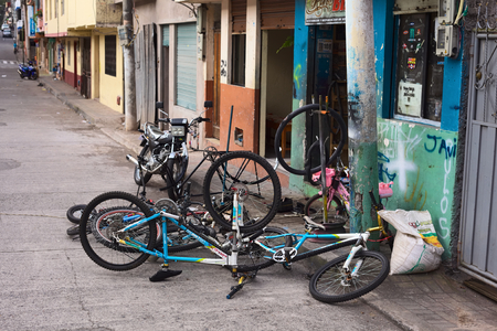 motorcycle repair shop: BANOS, ECUADOR - AUGUST 1, 2014: Bicycles in front of a bike repair shop on Juan Leon Mera street on August 1, 2014 in Banos, Ecuador. Banos is a small touristy town in Tungurahua Province in Central Ecuador.