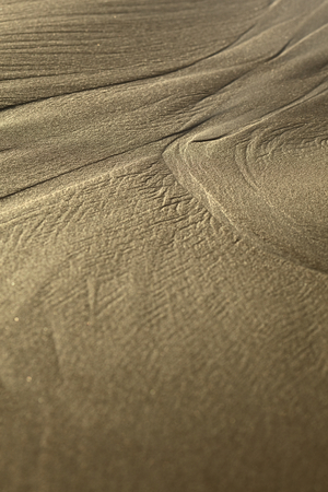 two and two thirds: Lines formed by the water on sandy beach in the small town of Mancora in Northern Peru (Selective Focus, Focus two thirds into the image where the line branches out into two) Stock Photo