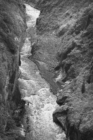 tungurahua: Monochrome image of the canyon of the Pastaza River photographed from the San Francisco Bridge in the small town of Banos in Tungurahua Province, Central Ecuador