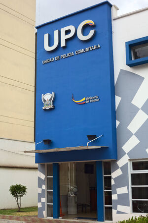 police unit: QUITO, ECUADOR - AUGUST 6, 2014: Building of UPC (Unidad de Policia Comunitaria, Communitarian Police Unit) on Gil. Ramirez Davalos Street on August 6, 2014 in Quito, Ecuador