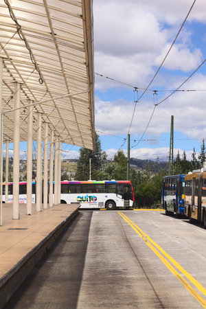 QUITO, ECUADOR - AUGUST 8, 2014: An empty local bus with Quito Alcaldia sign on it standing outside the Terminal Terrestre Quitumbe (long-distance bus terminal) on August 8, 2014 in Quito, Ecuador