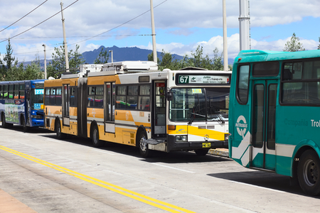 trackless: QUITO, ECUADOR - AUGUST 8, 2014: Trolleybus of the local public transportation system standing outside the Quitumbe Terminal Terrestre (long-distance bus terminal) on August 8, 2014 in Quito, Ecuador Editorial