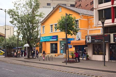 ignacio: QUITO, ECUADOR - AUGUST 6, 2014: Banco Bolivariano on the corner of Amazonas Avenue and Ignacio de Veintimilla Street with unidentified pedestrians walking on sidewalk in the tourist district of La Mariscal on August 6, 2014 in Quito, Ecuador