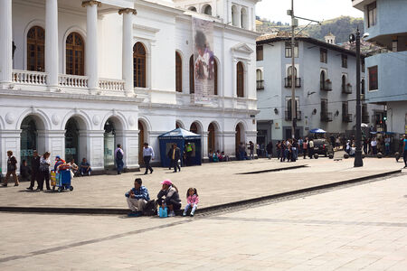 QUITO, ECUADOR - AUGUST 4, 2014: Unidentified people sitting and walking on the Plaza del Teatro (Theater Square) in front of the Sucre Theater in the historic city center on August 4, 2014 in Quito, Ecuador. Quito is an UNESCO World Cultural Heritage Sit