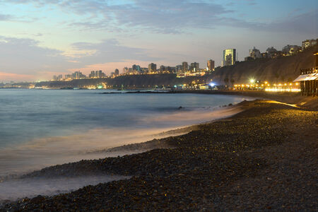 The coast of the district of Miraflores, Lima, Peru at dusk photo