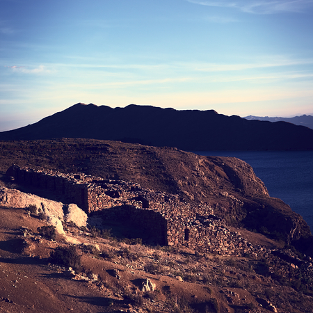 Chinkana archeological site of Tiwanaku (Tiahuanaco) origin on the Northwestern part of the Isla del Sol (Island of the Sun) on Lake Titicaca in Bolivia lit by the setting sun. Isla del Sol is a popular tourist destination and is reachable by boat from Co photo