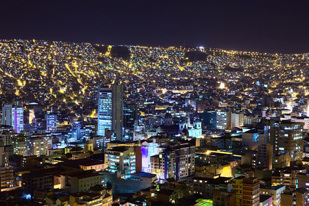 View over the city center of La Paz, Bolivia at night. The Metropolitan Cathedral can be seen a bit to the right from the center of the image. photo