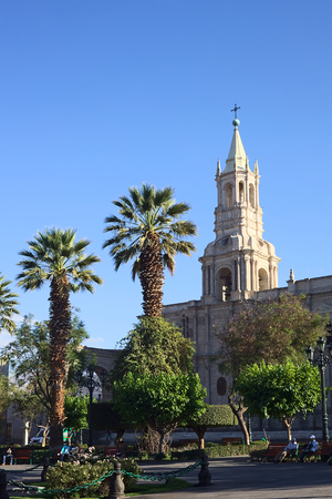unesco world cultural heritage: AREQUIPA, PERU - OCTOBER 8, 2014: Plaza de Armas (main square) and the Basilica Cathedral in the historical city center early in the morning on October 8, 2014 in Arequipa, Peru. Arequipa is an UNESCO World Cultural Heritage Site.
