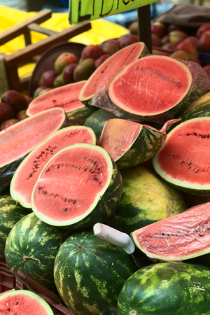 roadside stand: LA PAZ, BOLIVIA - NOVEMBER 10, 2014: Watermelon stand along Max Paredes street in the city center, where many fruits and vegetables are sold on the roadside on November 10, 2014 in La Paz, Bolivia (Selective Focus, Focus one third into the image)