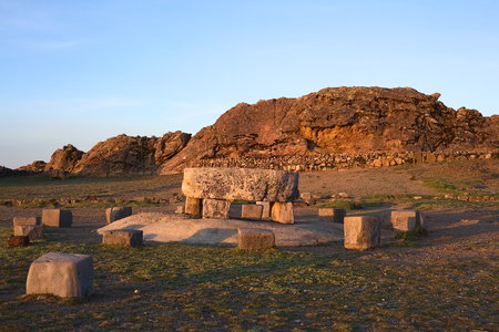 The Ceremonial Table and behind it the Rock of the Puma (Titicaca) popular archeological sites of Tiwanaku and Inca origin on Isla del Sol (Island of the Sun) in Lake Titicaca, Bolivia photographed at sunset photo