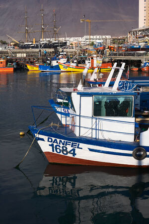 anchoring: IQUIQUE, CHILE - JANUARY 22, 2015: Fishing boats anchoring in the harbor on January 22, 2015 in Iquique, Chile. Iquique is a free port city in Northern Chile. Editorial