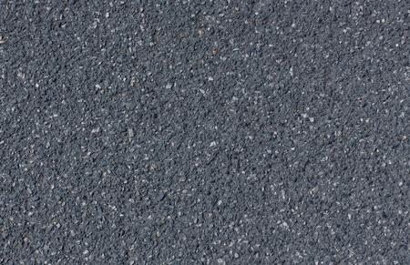 Old black grainy asphalt with gravel texture background
