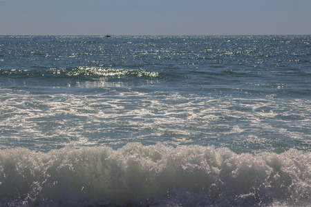 The beauty of the raging sea waves. And sunny stars glowing in them. Aegean sea, Asprovalta.
